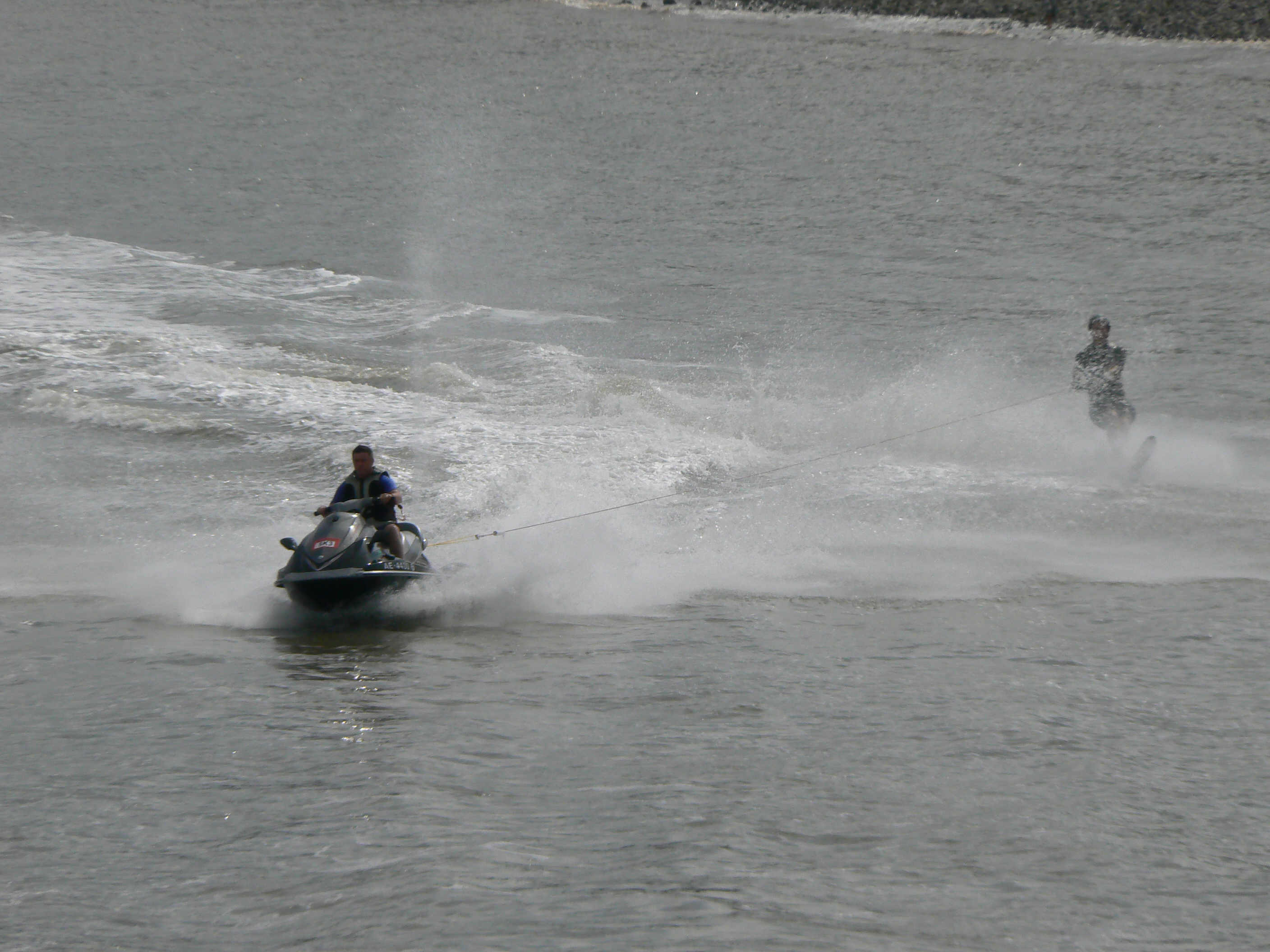 Skiing behind the club jetski off Penarth